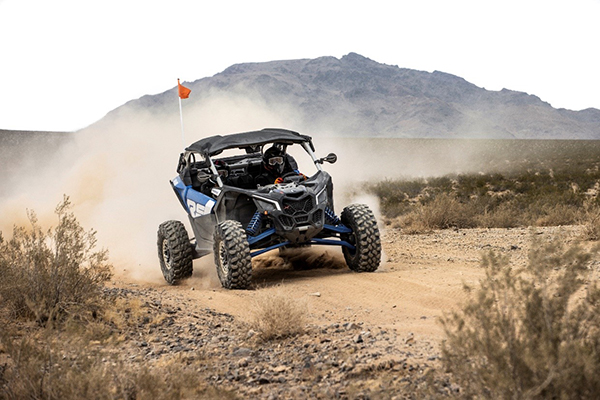 The 2022 Can-Am Maverick X3 X rs Turbo RR features an industry-leading 200 horsepower. Buckle up. It's go time. ©BRP 2021